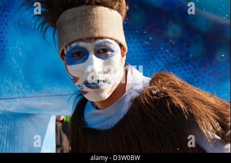 Portrait of a young masked man participating in the Carnival of Nice parade in costume. - Stock Photo