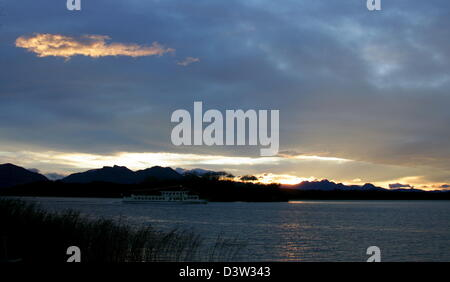 The picture shows the sunset over the Fraueninsel (island) at the Chiemsee (Lake) in Prien, Germany, 08 December - Stock Photo