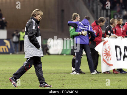 1.FC Cologne's head coach Christoph Daum (L) passes a group of jubilating players of Eintracht Frankfurt after the - Stock Photo
