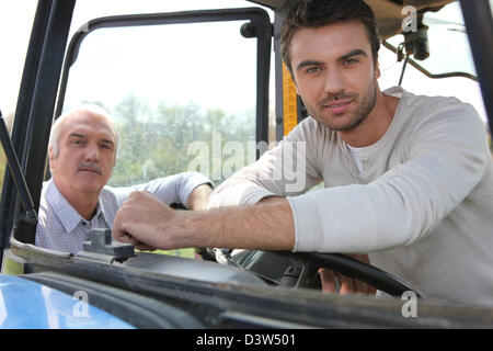 Sitting in tractor - Stock Photo