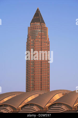 The picture shows the Messeturm (Fair Tower) behind the new Messehalle 3 (Fair Hall) in Frankfurt Main, Germany, - Stock Photo