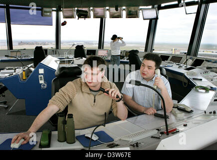 Air-traffic controllers Tilo Blaenschdorf (R) and Paul Diestelkamp (L) communicate with the pilots in the control - Stock Photo