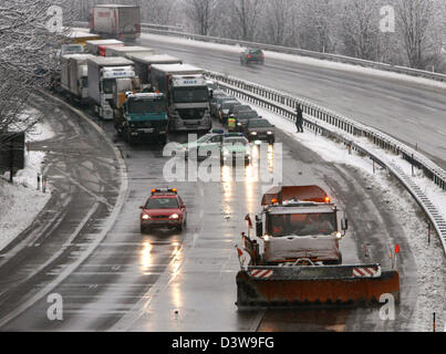 The police has closed down the motorway completely while a snow clearing vehicle frees the road from snow near Bad - Stock Photo