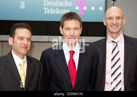 Deutsche Telekom CEO Rene Obermann (C), member of the board Hamid Akhavan (L) and new CEO of T-Com Timotheus Hoettges - Stock Photo