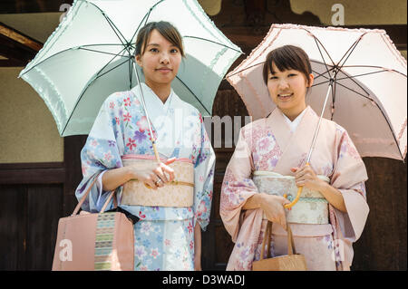 Women dressed with  kimono in the streets of Kyoto, Japan, Asia - Stock Photo