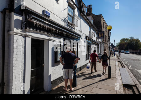 A couple look at the menus outside the Loch Fyne restaurant, Trumpington Street, Cambridge, Cambridgeshire, UK - Stock Photo