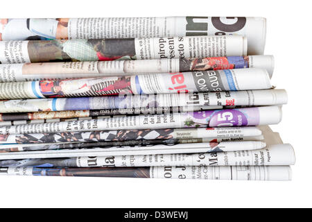 Pile of newspapers isolated on a white background. Concept communication - Stock Photo