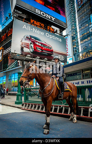 A New York City Police officer on a horse in Times Square. Manhattan, NYC. - Stock Photo
