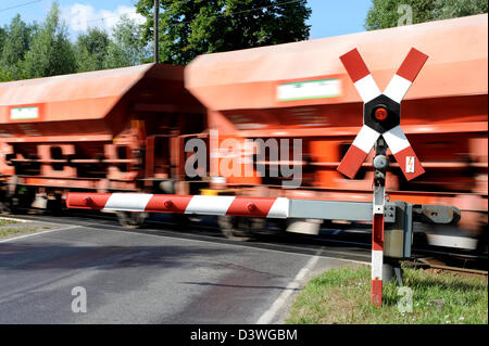 Zossen, Germany, a drive through freight train at a railroad crossing - Stock Photo