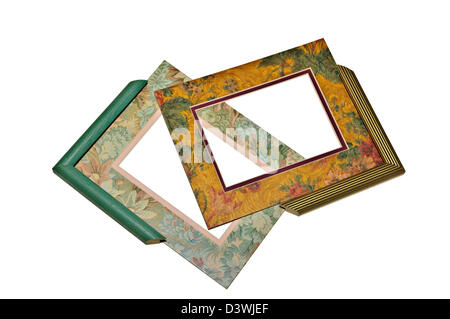 Two colorful floral mats and sample frame corners. - Stock Photo