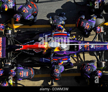 Sebastian Vettel (GER),Red Bull Racing RB9 and his mechanics practice pit stop during Formula One tests on Circuit - Stock Photo