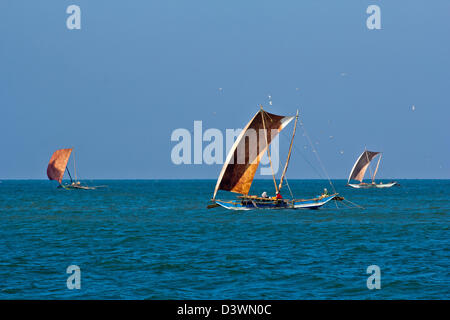 THREE CATAMARANS IN THE MORNING FISHING FOR PRAWNS IN THE INDIAN OCEAN NEAR TO THE BEACHES OF SRI LANKA - Stock Photo