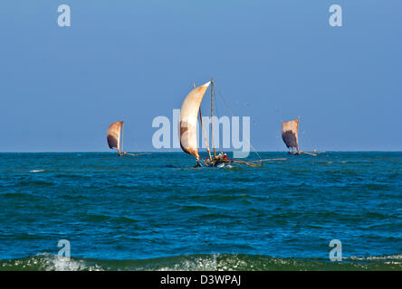 THREE CATAMARANS IN THE MORNING FISHING FOR PRAWNS INDIAN OCEAN SRI LANKA - Stock Photo