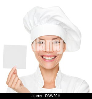 Beautiful young multicultural Asian / Caucasian female chef, baker or cook showing blank sign isolated on white - Stock Photo