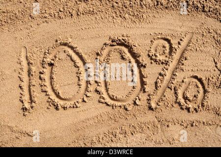 100% written on a sandy beach. - Stock Photo