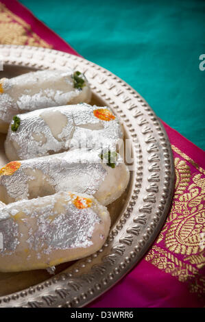 Cham cham a traditional Indian sweet made from chhena (cottage cheese) and khoya (solid milk) - Stock Photo