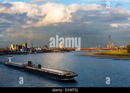 Cargo, freight ship on river Rhine, Duisburg, Germany. - Stock Photo