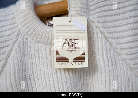 White wool knitwear jumper on sale at the Falkland Islands Agency shop, Wells, Somerset, England - Stock Photo