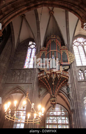 Candleholder and organ of Strasbourg cathedral in Strasbourg, Alsace, France - Stock Photo