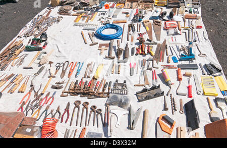 Second hand tools laid out on a sheet at the flea market at Playa del Inglés, Gran Canaria - Stock Photo