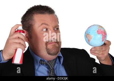Angry man straying globe - Stock Photo