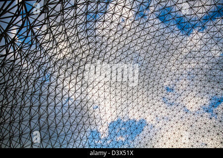 Abstract metallic background and blue sky at Montreal Biosphere. - Stock Photo
