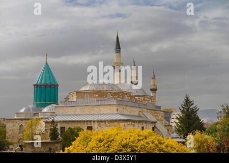 Tomb of Rumi Mevlevi founder at Mevlana Museum with Selimiye and Aziziye mosque minarets Konya Turkey - Stock Photo