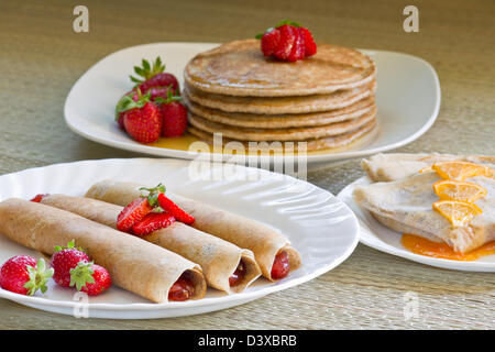 Dessert with strawberries roll crepes pancakes and crepes suzette - Stock Photo