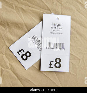 Pound price tags for upper body clothes, England, United Kingdom, Europe - Stock Photo