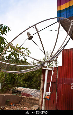Satellite dishes. Be installed in a corner of the house. - Stock Photo