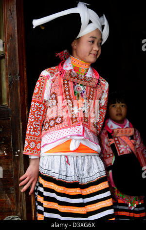 A Long Horn Miao teenage girl dressed in traditional costume and headgear  for the Tiao Hua festival in Guizhou. - Stock Photo