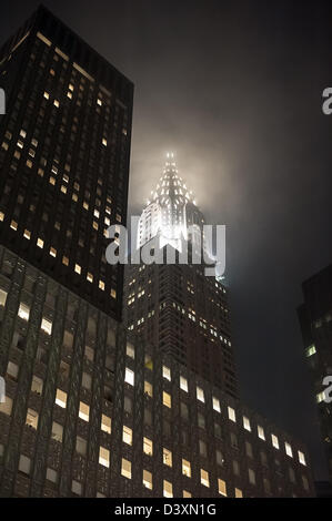 The eerie sight of New York's Chrysler Building shrouded in fog at night.