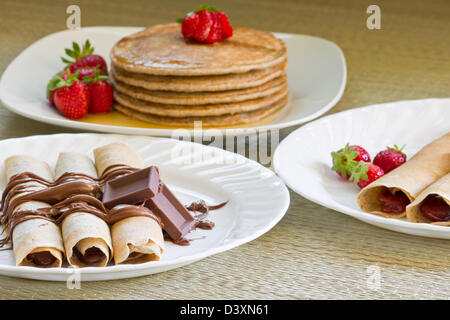 Dessert with the strawberries and chocolate roll crepes and pancakes. - Stock Photo