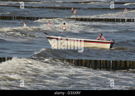 Koserow, Germany, timber groynes in the Baltic Sea and fishing boat