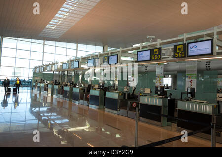 Check-in desks at El Prat aiport in Barcelona, Spain, Europe - Stock Photo