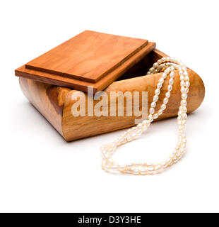 Wooden jewelry box with a pearl necklace isolated on white background - Stock Photo