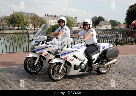 Two French motorcycle National Police officers on patrol in Meaux, Seine-et-Marne, Île-de-France, near Paris, France. - Stock Photo