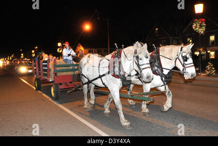 A horse drawn carriage ride at night in Old Saybrook, CT USA - Stock Photo