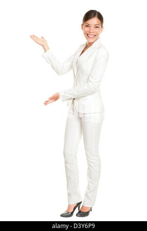Full length of mixed race Chinese Asian / Caucasian businesswoman showing and presenting something isolated on white - Stock Photo