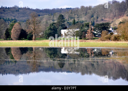 Bucks - Hambleden - river Thames at Mill End - unique reflections in a flooded field Greenlands - mansion circa - Stock Photo