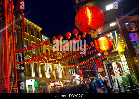 Chinese New Year Restaurant lanterns lit up on a busy night in Chinatown Soho London UK - Stock Photo