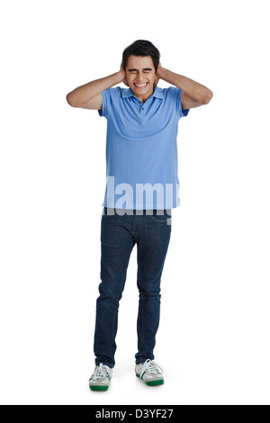Man covering his ears with his hands - Stock Photo