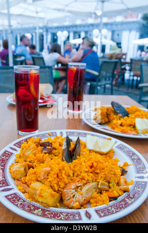 Paella for two. Main Square, Madrid, Spain. - Stock Photo