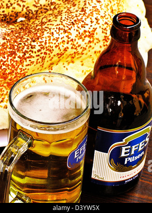 Turkish Efes Pilsen Beer and Pitta Bread, Istanbul, Turkey - Stock Photo