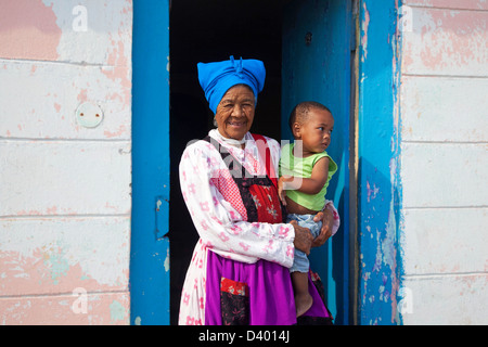 Grandmother with child in front of her house in township near Swakopmund, Namibia, South Africa - Stock Photo