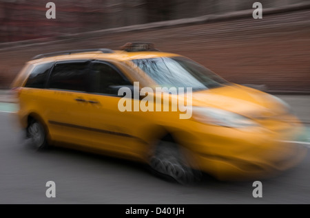 A medallion hybrid yellow taxi cab in New York City - Stock Photo