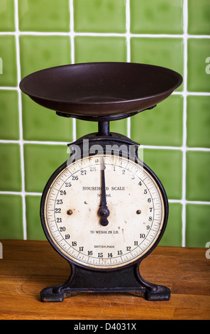 Old mechanical Pan Scales in a Kitchen - Stock Photo