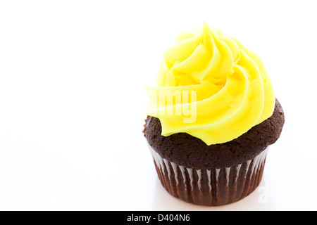 Gourmet cupcakes with yellow icing prepared for Easter. - Stock Photo