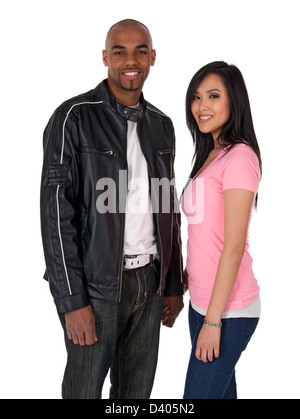 Smiling couple holding hands - African American guy with Asian girlfriend. - Stock Photo