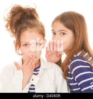 children whispering secrets shocking secrets scandal and gossip - Stock Photo